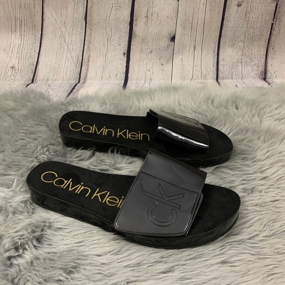 eebc98c4a70c4 Calvin Klein Black Marlina Flat Slide Sandals